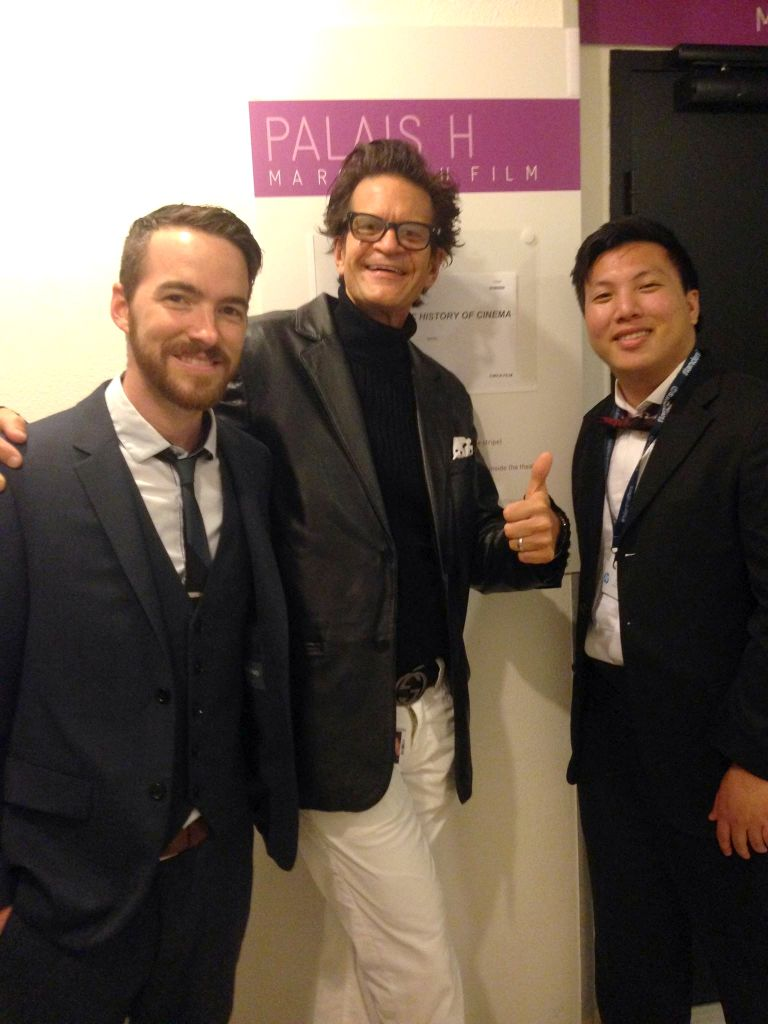 Three big-wig Hollywood producers Adam Sutton, Tom Garrett, and Jordan Ong celebrate the success of their film's screening at Cannes 2015